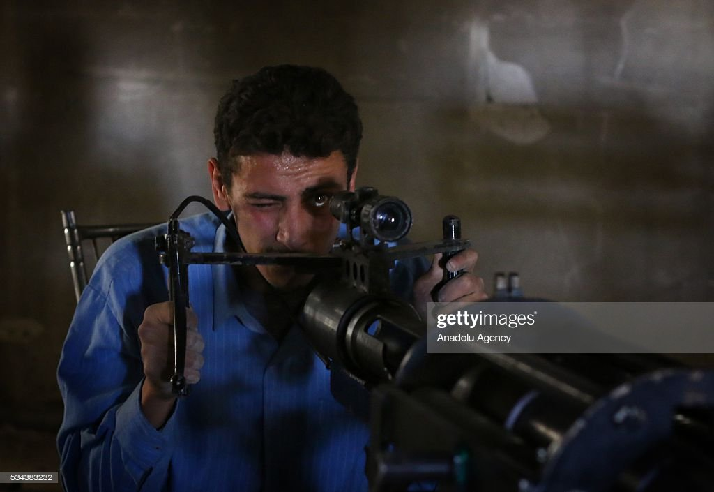 A member of the Syrian opposition takes aim at Syrian regime forces during the clashes at Eastern Ghouta district of Damascus, Syria on May 26, 2016.