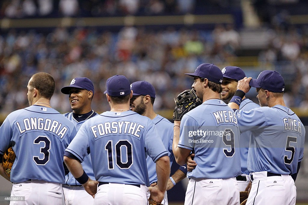 Member of the Tampa Bay Rays smiles as they react to seeing a replay of what was originally ruled as a catch by right fielder <a gi-track='captionPersonalityLinkClicked' href=/galleries/search?phrase=Wil+Myers&family=editorial&specificpeople=7562808 ng-click='$event.stopPropagation()'>Wil Myers</a> #9 of the Tampa Bay Rays on Brett Gardner of the New York Yankees during the fourth inning of a game on April 20, 2014 at Tropicana Field in St. Petersburg, Florida. The play was overturned on review and ruled a ground rule double by Gardner to score Alfonso Soriano of the New York Yankees