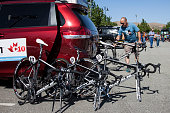 A member of the 'Team Spidertech Powered By C10' team prepares bicycles prior to Stage 6 of the AMGEN Tour of California