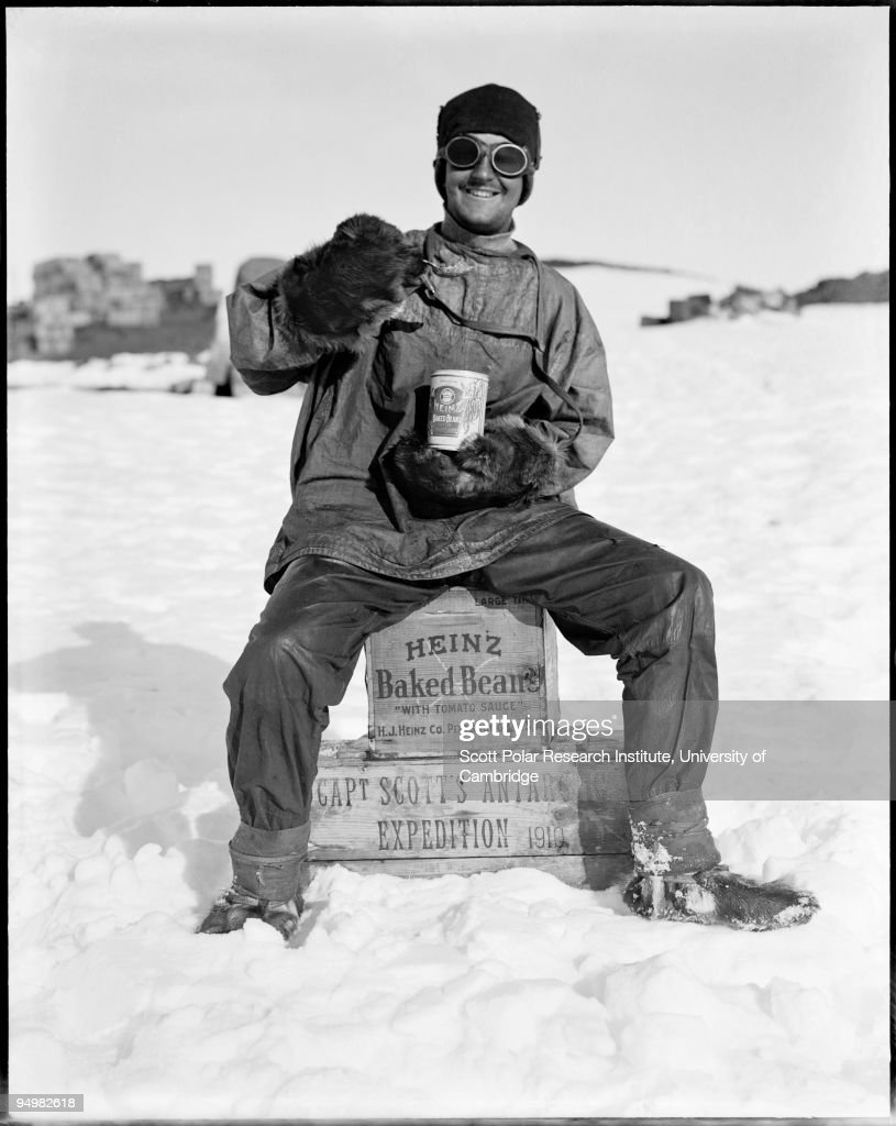 A member of the team tucks into a tin of Heinz baked beans in the Ross Dependency, during Captain Robert Falcon Scott's Terra Nova Expedition to the Antarctic, January 1912.