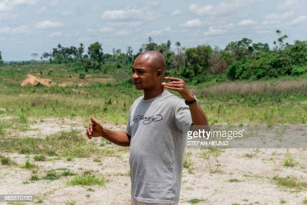 A member of the the Obung community gestures as he speaks about the Cross River Super Highway as he stands on the ground breaking site in Calabar on...