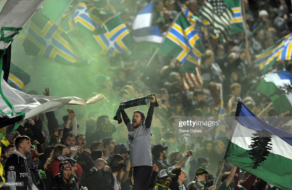 A member of the 'Timbers Army' celebrates after the Portland Timbers scored a goal during the second half of the game against the Montreal Impact at Jeld-Wen Field on March 09, 2013 in Portland, Oregon. Montreal won the game 2-1.
