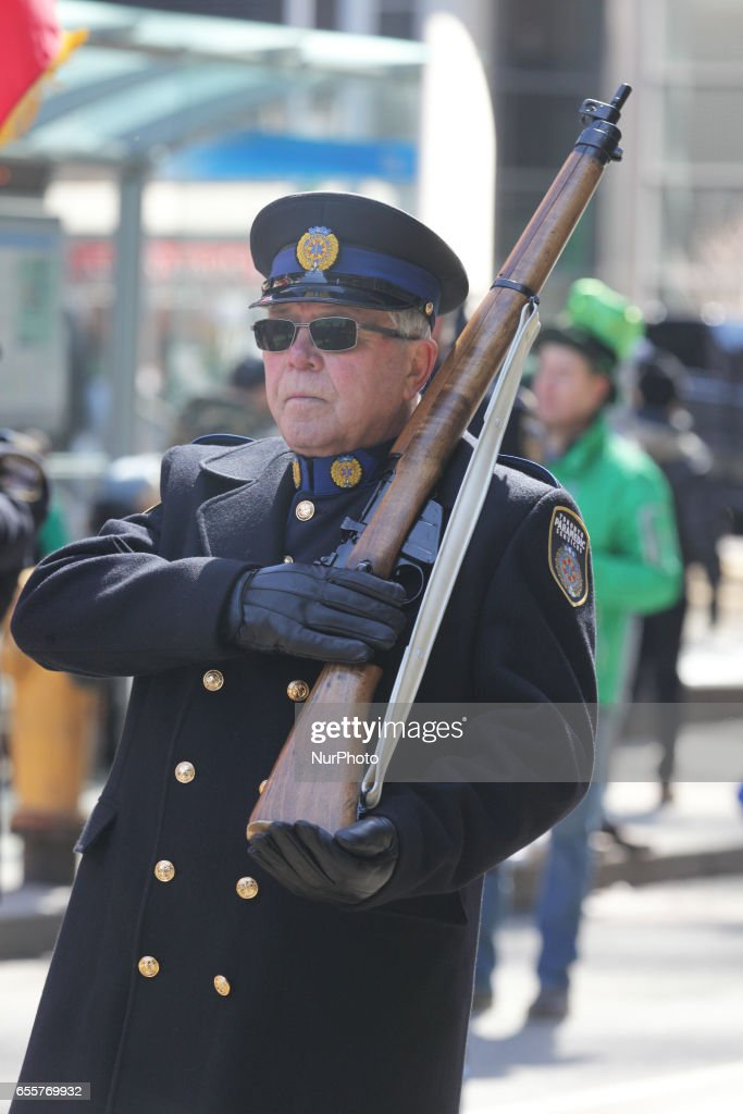 A member of the Toronto Paramedic Services carries a rifle during the St. Patrick's Day Parade in Toronto, Ontario, Canada, on March 19, 2017.