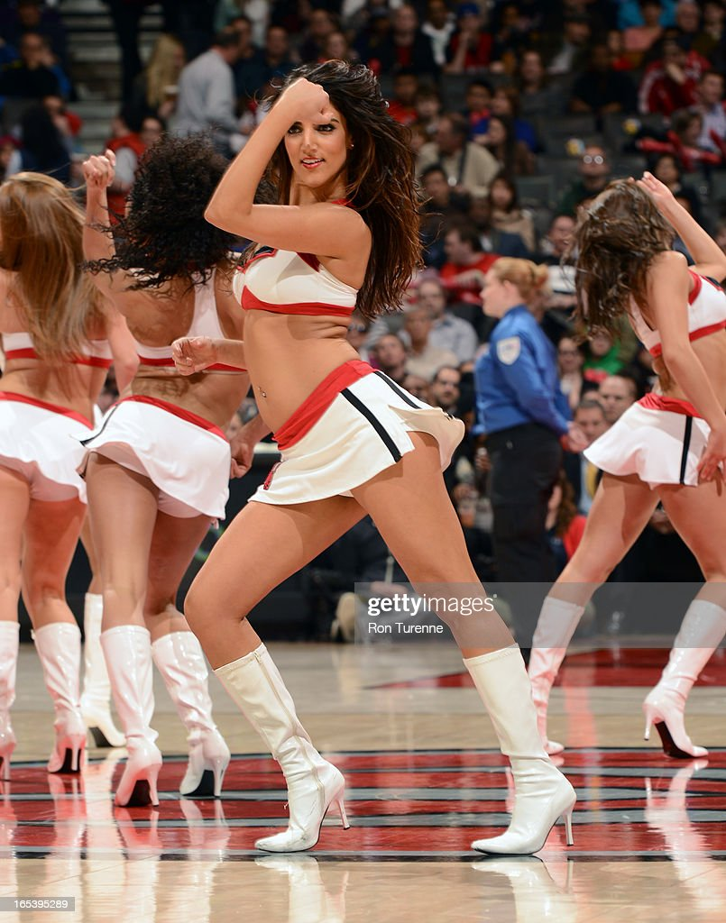 A Member of the Toronto Raptors Dance Team gets the crowd pumped up against the Washington Wizards during the game on April 3, 2013 at the Air Canada Centre in Toronto, Ontario, Canada.