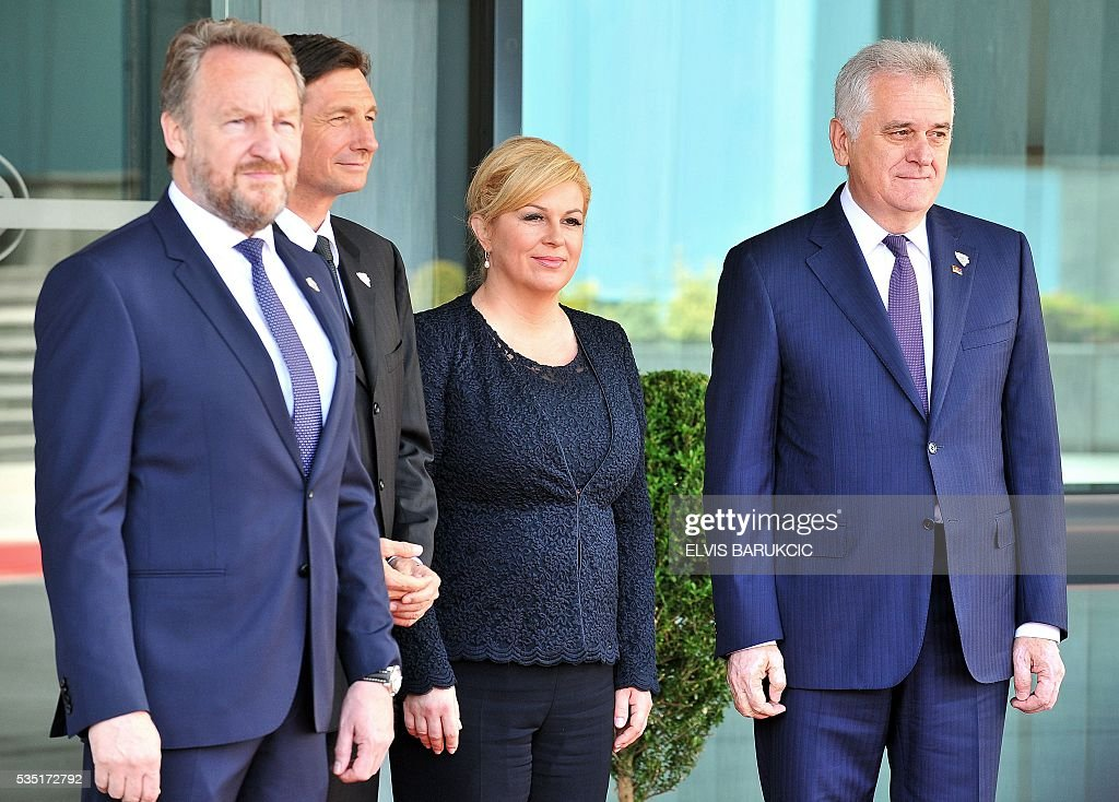 Member of the Tripartite Bosnian Presidency Bakir Izetbegovic, President of Slovenia Borut Pahor, Croatian President Kolinda Grabar-Kitarovic and President of Serbia Tomislav Nikolic pose at Bosnia and Herzegovina's National Assembly in Sarajevo, on May 29, 2016. Heads of western Balkan nations meet for an annual summit during which they will discuss regional cooperation. / AFP / ELVIS