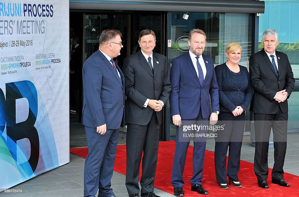 Member of the Tripartite Bosnian Presidency Mladen Ivanic, President of Slovenia Borut Pahor, Member of the Tripartite Bosnian Presidency Bakir Izetbegovic, Croatian president, Kolinda Grabar-Kitarovic and Member of the Tripartite Bosnian Dragan Covic pose at Bosnia and Herzegovina's National Assembly in Sarajevo, on May 29, 2016. Heads of western Balkan nations meet for an annual summit during which they will discuss regional cooperation. / AFP / ELVIS