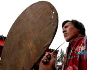 A member of the Tu ethnic minority group holds a worship tool as he prays at a worship ceremony for the Dragon God at Yaoma Village on April 11 2005...