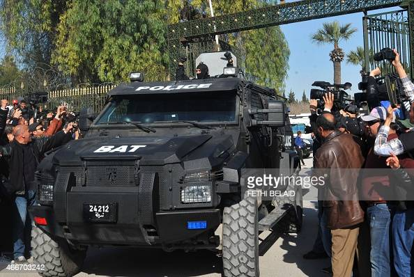 A member of the Tunisian special security forces jubilates after killing two gunmen who attacked Tunis' famed Bardo Museum on March 18 2015 At least...