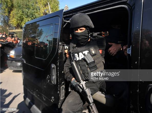 A member of the Tunisian special security forces sits in a car after the killing of two gunmen who attacked Tunis' famed Bardo Museum on March 18...
