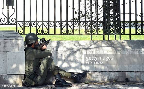 A member of the Tunisian special security forces takes position after two gunmen attacked Bardo International Museum on March 18 2015 in Tunis At...