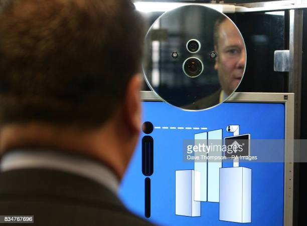 A member of the UK Border Agency has his face scanned on the new facial recognition system at Manchester Airport