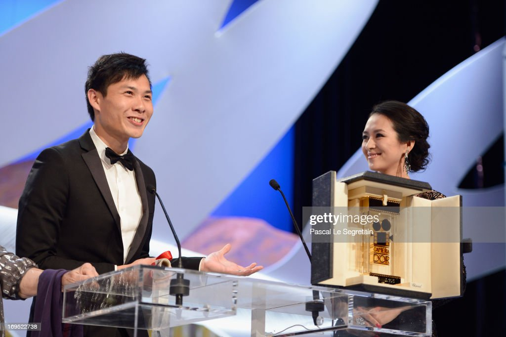 Member of the Un Certain Regard Jury Zhang Ziyi (R) presents director Anthony Chen with the Camera d'Or for 'Ilo Ilo' during the Closing Ceremony during the 66th Annual Cannes Film Festival at the Palais des Festivals on May 26, 2013 in Cannes, France.