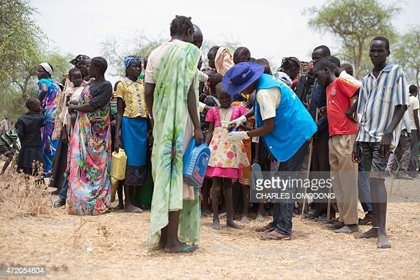 A member of the UN World Food Programme and United Nations Children's Fund register new Internally Displaced People as they arrive on May 2 2015 in...