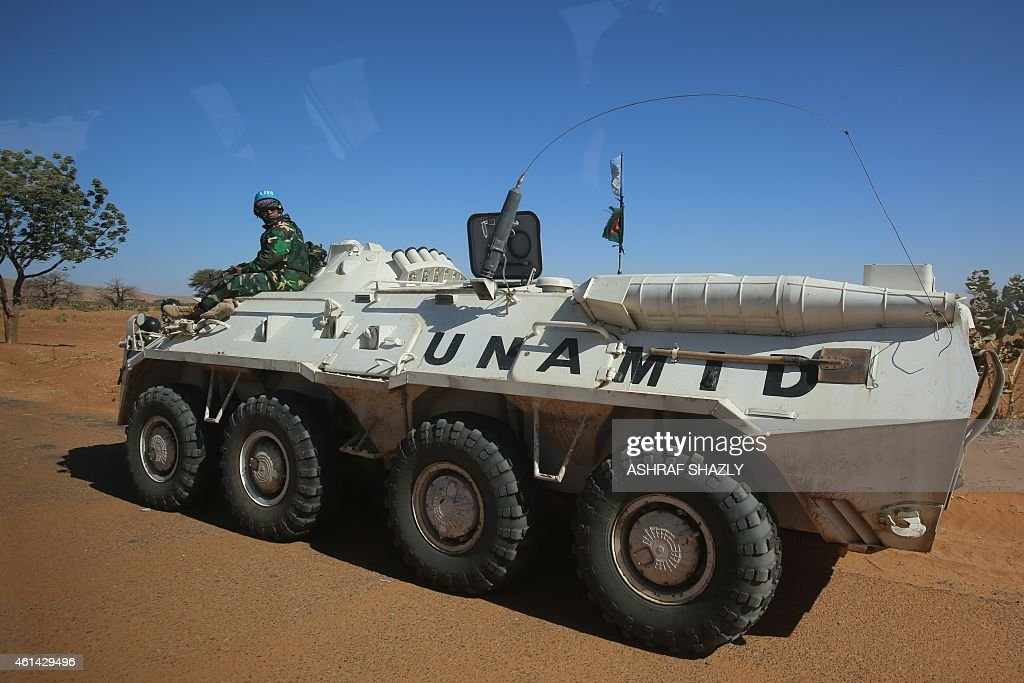A member of the UNAfrican Union mission in Darfur sits on an armoured personnel carrier patrolling near the city of Nyala in Sudan's Darfur on...