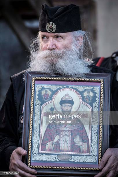 A member of the ' Union of Orthodox BannerBearers' holds an icon depicting the last Russian Tsar and Saint Nikolay II during a demonstration against...