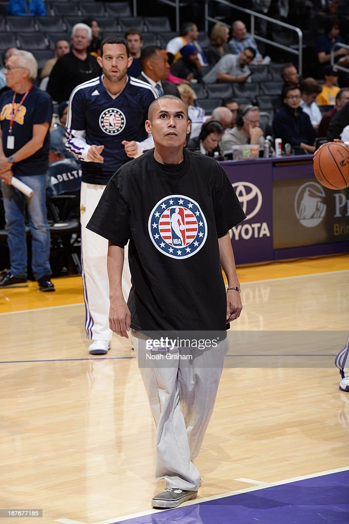 A member of the United States armed forces participates as a ballboy before a game between the Minnesota Timberwolves and the Los Angeles Lakers at Staples Center on November 10, 2013 in Los Angeles, California.