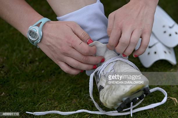 A member of the University of Mary Washington Women's Soccer team removes her cleats April 16 2015 at the University of Mary Washington a coed school...