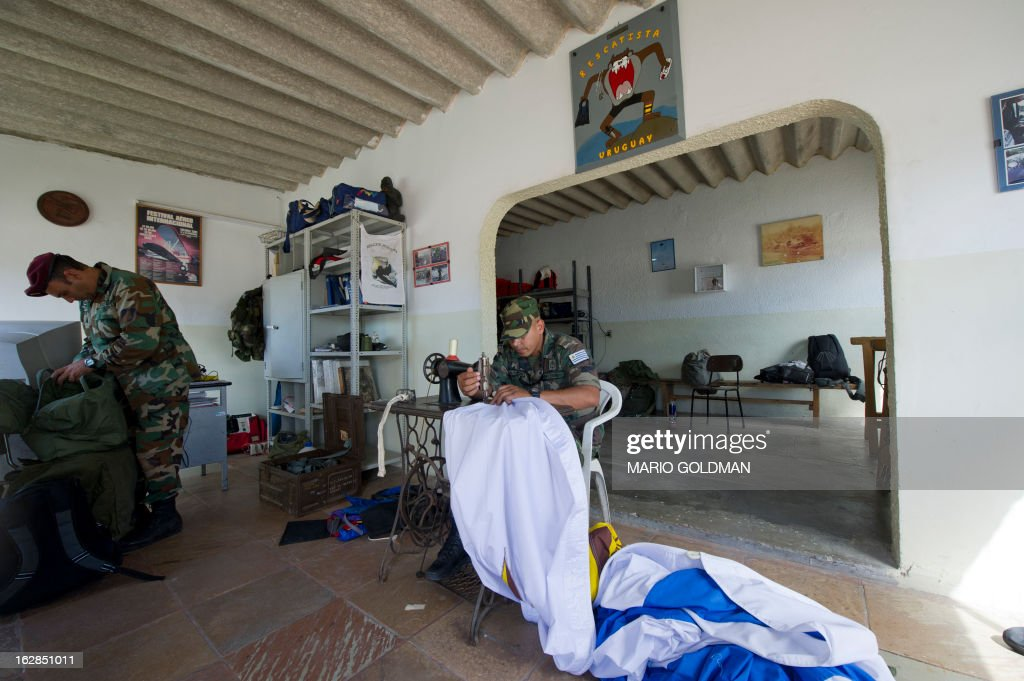 A member of the Uruguayan Air Force Brigade 1 repairs a parachute at the Air Base in Canelones, near Montevideo, on February 27, 2013. AFP PHOTO/Mario Goldman