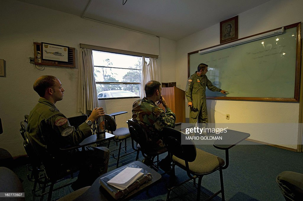 A member of the Uruguayan Air Force gives a briefing of a flight before a drill at the Brigade 1 headquarters in Montevideo, Uruguay on February 26, 2013. AFP PHOTO/Mario Goldman
