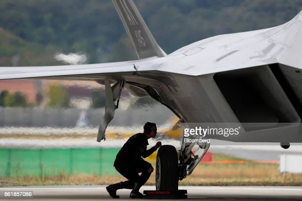 A member of the US Air Force inspects an F22 Raptor fighter jet manufactured by Lockheed Martin Corp during a press day of the Seoul International...