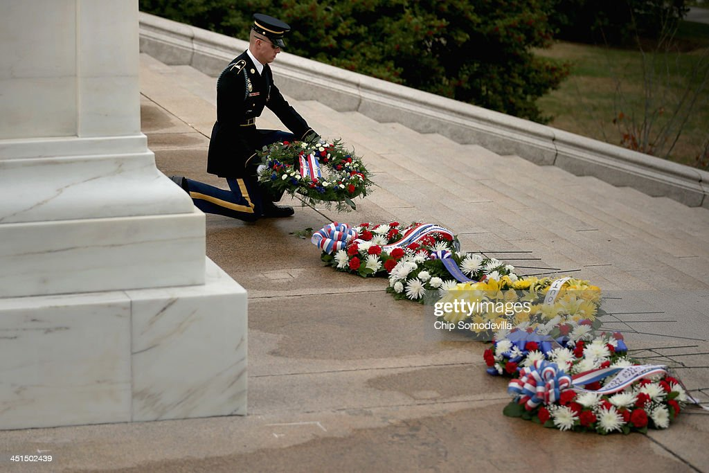 A member of the U.S. Army 3rd Infantry Regiment, called ''The Old Guard,'' sets a wreath at the base of the Tomb of the Unknowns during a ceremony in honor of former President John F. Kennedy at Arlington National Cemetery November 22, 2013 in Arlington, Virginia. Remembrance ceremonies were held arcoss the United States today, the 50th anniversary of the assisination of President Kennedy.