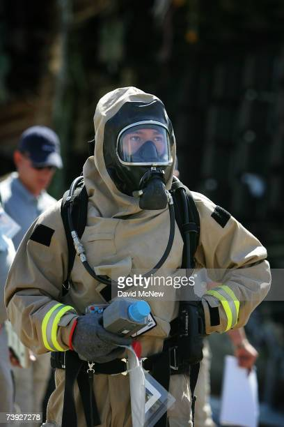 A member of the US Army 9th Civil Support Team prepares to enter a hazardous crash zone during an exercise simulating mass casualties from the...