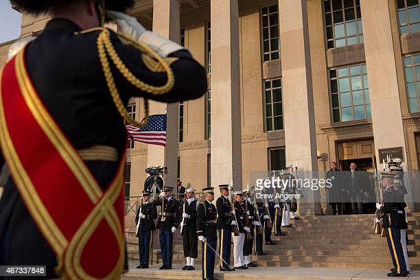A member of the US Army Band salutes US Defense Secretary Ash Carter and Afghan President Ashraf Ghani during an honor cordon ceremony at the...