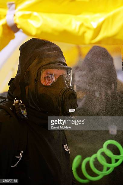 A member of the US Army Civil Support Team is sprayed by his partner during decontaminated at an exercise simulating mass casualties from the...