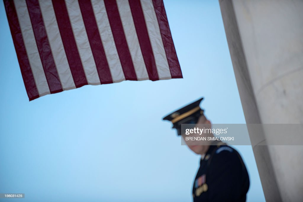 A member of the US Army honor guard stands near the amphitheater where US President Barack Obama speaks during Veterans' Day ceremonies at Arlington National Cemetery November 11, 2012 in Arlington, Virginia. AFP PHOTO/Brendan SMIALOWSKI