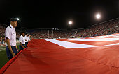 A member of the US Army ROTC hold the flag during the National Anthem during a game between the Florida Atlantic Owls and the Miami Hurricanes at FAU...