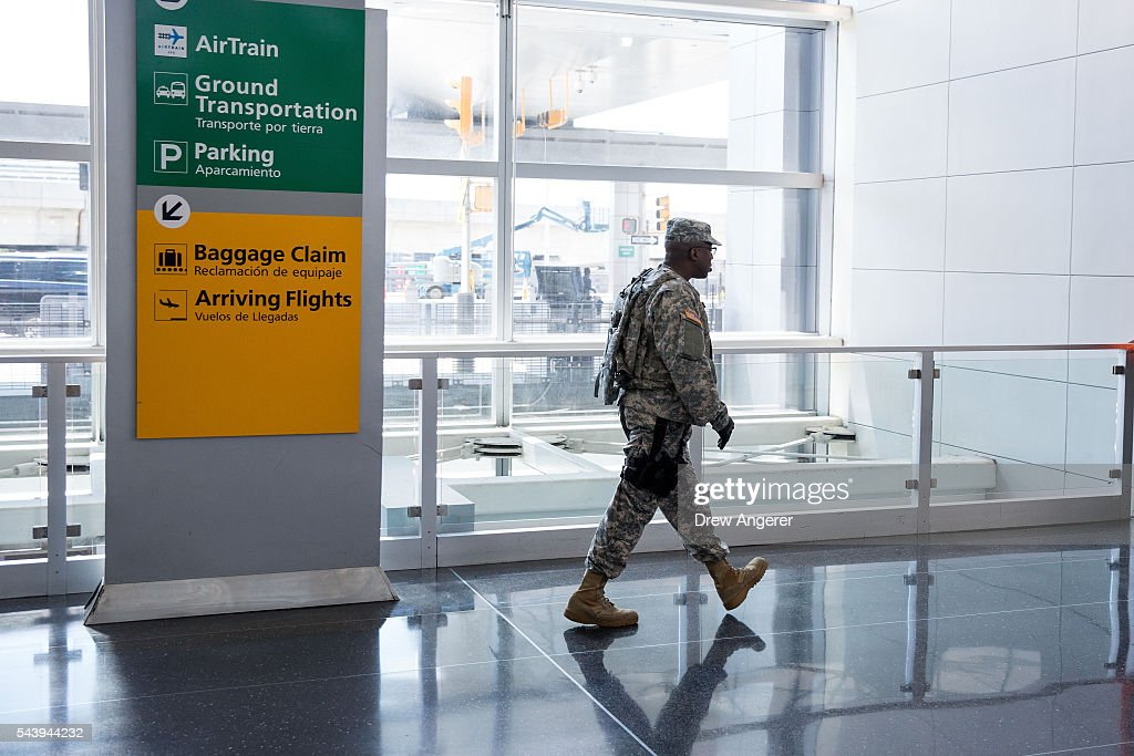 A member of the U.S. Army walks through John F. Kennedy International Airport, June 30, 2016 in the Queens borough of New York City. Following Tuesday's terrorist attacks at Instanbul's Ataturk Airport (JFK), the Transportation Security Administration and other law enforcement agencies have increased security at major airports in the United States.
