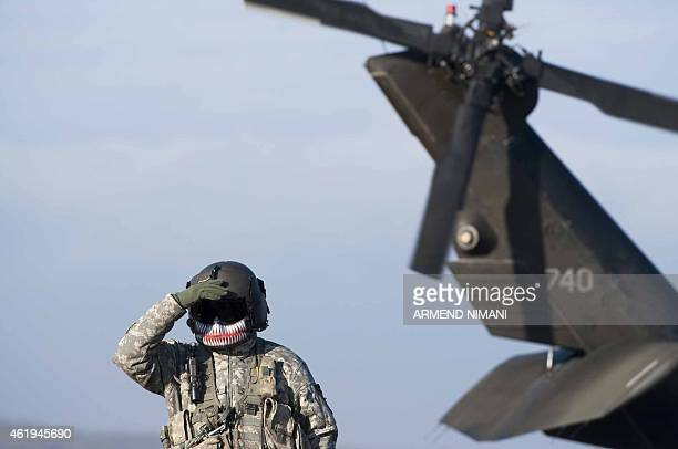 A member of the US Army's 4th Infantry Brigade Combat Team 25th Infantry Division part of the NATOled peacekeeping mission in Kosovo takes part in a...