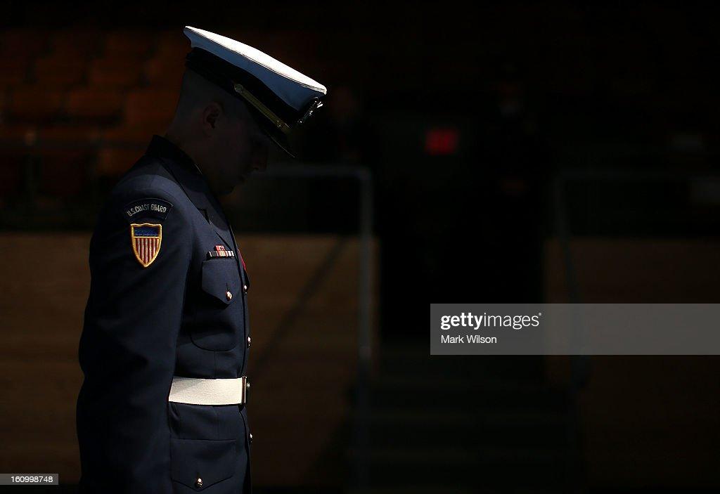 A member of the U.S. Coast Guard honor guard team stands in the shadows during a armed services farewell ceremony for Sec. Panetta at Joint Base Ft. Myer, on February 8, 2013 in Arlington, Virginia. If confirmed by the U.S. Senate, former U.S. Sen. Chuck Hagel (R-NE) will replace Panetta.