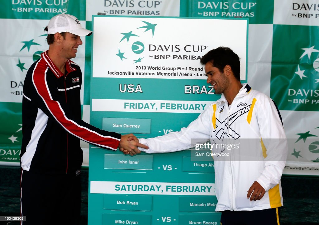 Member of the U.S. Davis Cup Team Sam Querrey shakes hands with member of the Brazil Davis Cup Team Thiago Alves following the Davis Cup Draw ceremony first round between the U.S. and Brazil at the Times-Union Center on January 31, 2013 in Jacksonville, Florida.