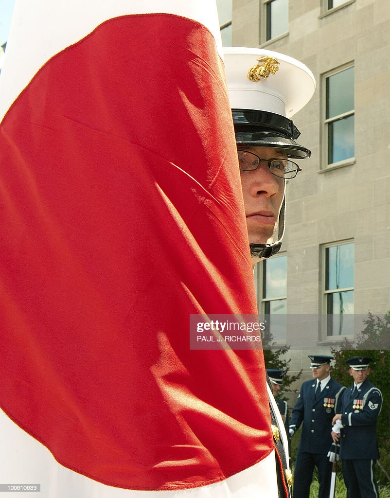 A member of the US Military Honor Guard carries the Japanese flag as he waits for ceremonies to begin with US Secretary of Defense Robert Gates and Japanese Defense Minister Toshimi Kitazawa before their private meetings on May 25, 2010 at the Pentagon in Washington. AFP PHOTO/Paul J. Richards