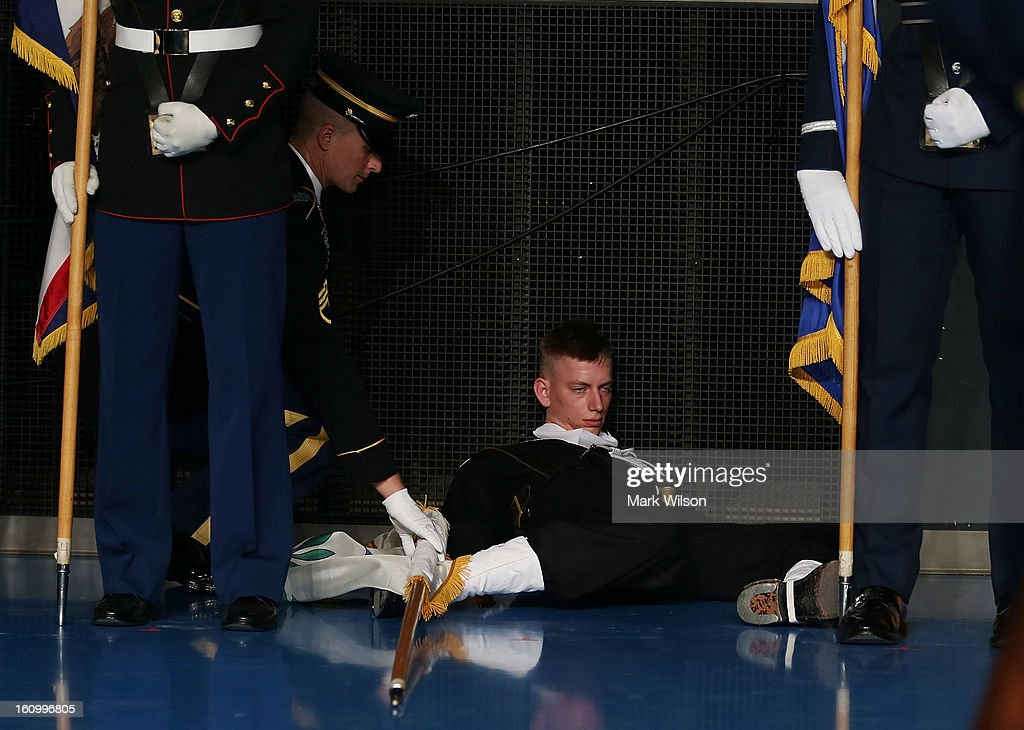 A member of the U.S. Navy collapses out of formation while holding a flag during an Armed Service farewell ceremony for Defense Secretary Leon Panetta at Joint Base Ft. Myer, on February 8, 2013 in Arlington, Virginia. If confirmed by the U.S. Senate, former U.S. Senator Chuck Hagel (R-NE),will replace Panetta.