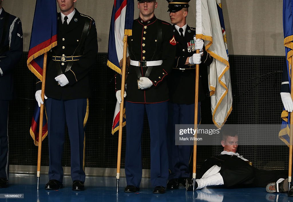 A member of the U.S. Navy falls out of formation while holding a flag during a armed services farewell ceremony for Defense Secretary Leon Panetta at Joint Base Ft. Myer on February 8, 2013 in Arlington, Virginia. If confirmed by the U.S. Senate former U.S. Senator Chuck Hagel (R-NE) will replace Panetta as Defense Secretary.