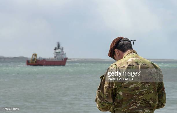 A member of the US Navy remains at Comodoro Rivadavia harbour as the Sophie Siem vessel departs after US Navy Undersea Rescue Command installed its...