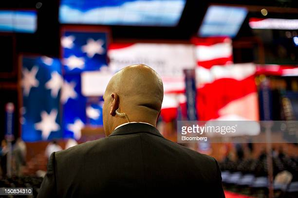 A member of the US Secret Service stands at a post on the floor of the Republican National Convention in Tampa Florida US on Monday Aug 27 2012 The...