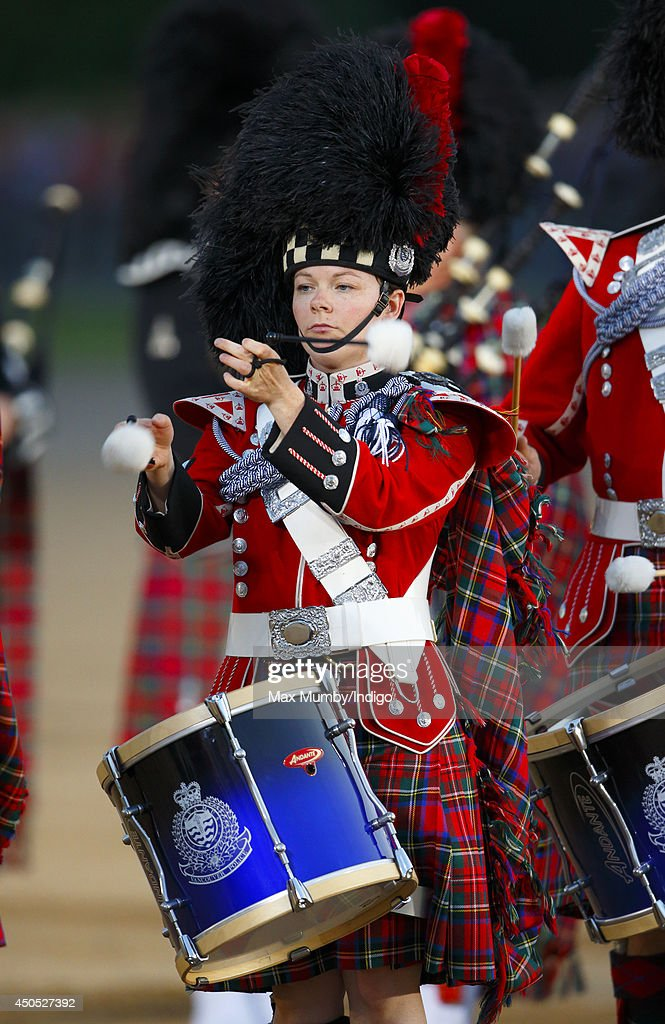 A member of the Vancouver Police Pipe Band performs in the Household Division's Beating Retreat, watched by Prince William, Duke of Cambridge on Horse Guards Parade on June 12, 2014 in London, England.