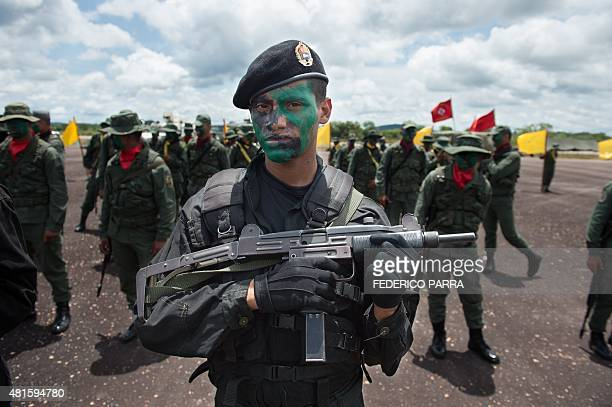 A member of the Venezuelan Army Special Forces takes part in a military parade in Tumeremo Bolivar State in Venezuela about 90 km from the border...