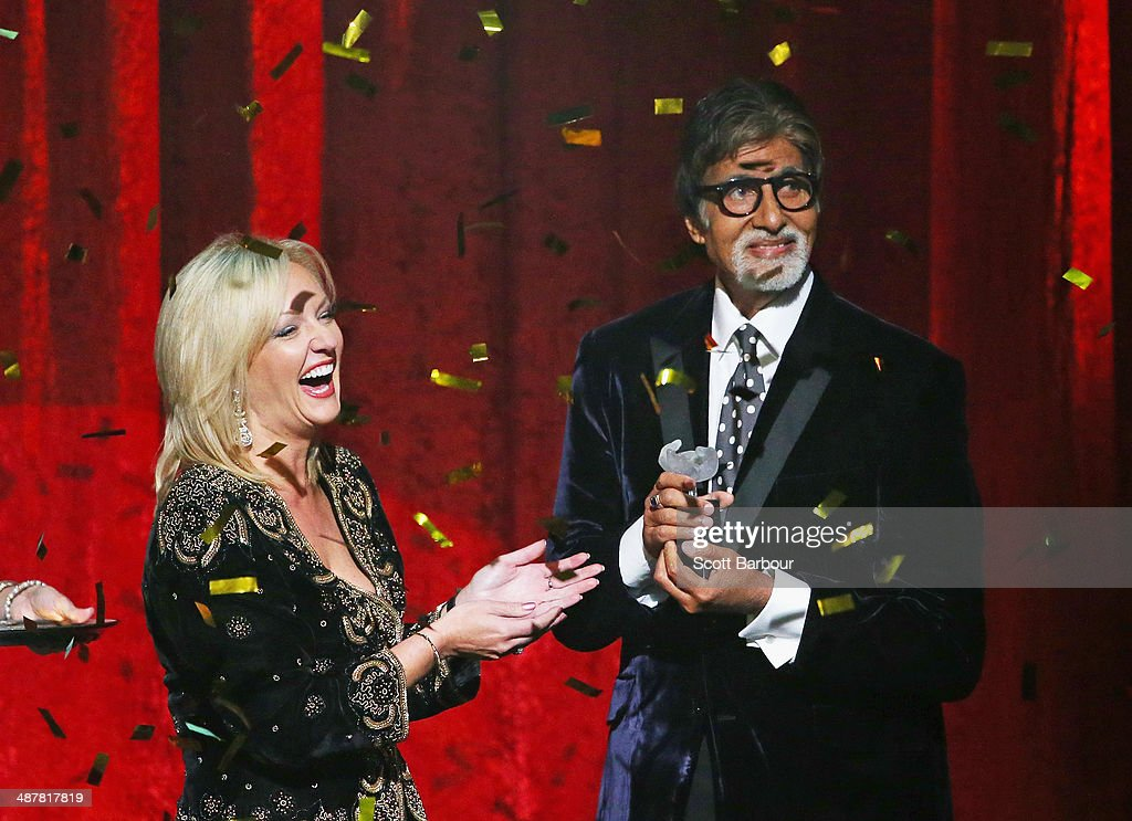Member of the Victorian Legislative Assembly, Heidi Victoria presents Indian film actor, <a gi-track='captionPersonalityLinkClicked' href=/galleries/search?phrase=Amitabh+Bachchan&family=editorial&specificpeople=220394 ng-click='$event.stopPropagation()'>Amitabh Bachchan</a> with the International Screen Icon Award during the Indian Film Festival of Melbourne Awards at Princess Theatre on May 2, 2014 in Melbourne, Australia.