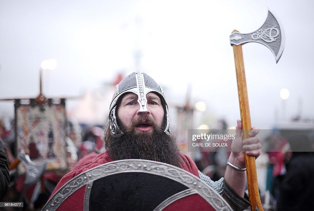 A member of the Viking Jarl Squad prepares for the start of the annual Up Helly Aa Festival in Lerwick Shetland Islands on January 26 2010 Up Helly...