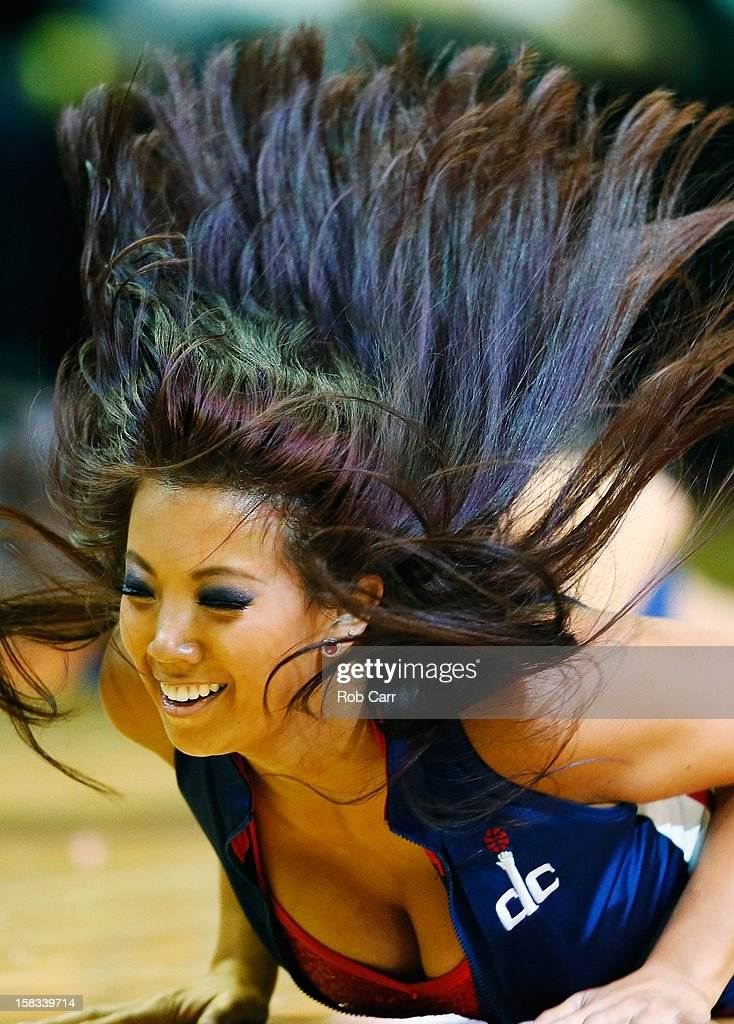 A member of the Washington Wizards Girls preforms during the Wizards and Miami Heat game at Verizon Center on December 4, 2012 in Washington, DC.
