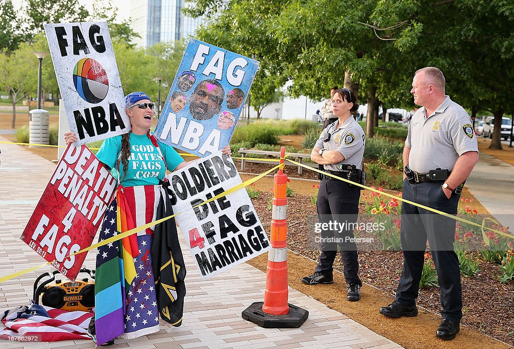 A member of the Westboro Baptist Church protests gay rights and the NBA as police officers look on before Game Five of the Western Conference Quarterfinals of the 2013 NBA Playoffs between the Oklahoma City Thunder and the Houston Rockets outside of Chesapeake Energy Arena on May 1, 2013 in Oklahoma City, Oklahoma.