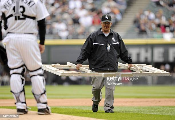 A member of the White Sox ground crew brings out the template to rechalk the batters box after Miguel Cabrera of the Detroit Tigers pointed out it...