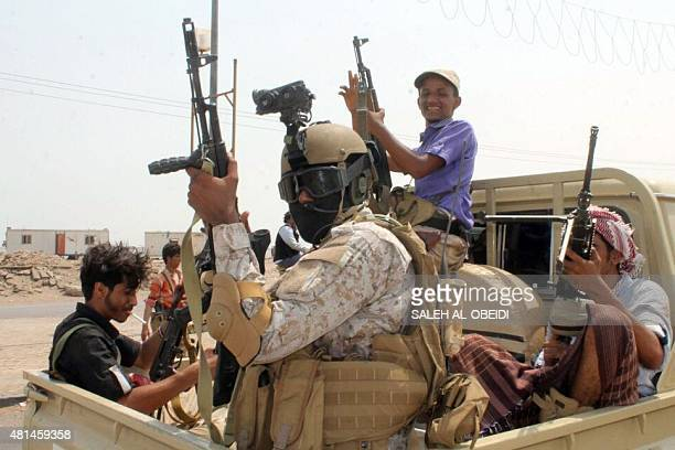 A member of the Yemeni special forces loyal to Saudibacked President Abedrabbo Mansour Hadi sits in the back of a truck in Aden's Tawahi...