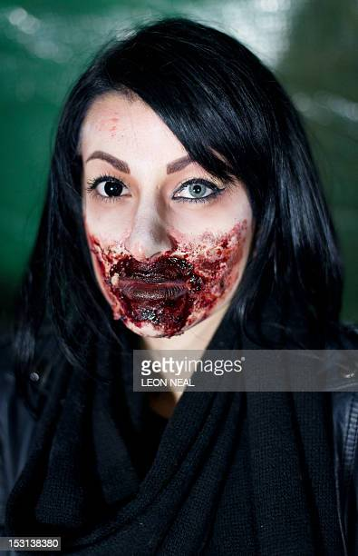 A member of the zombie makeup team poses during the last of three nights of the zombie chase game '28 Hours Later' in central Manchester northern...