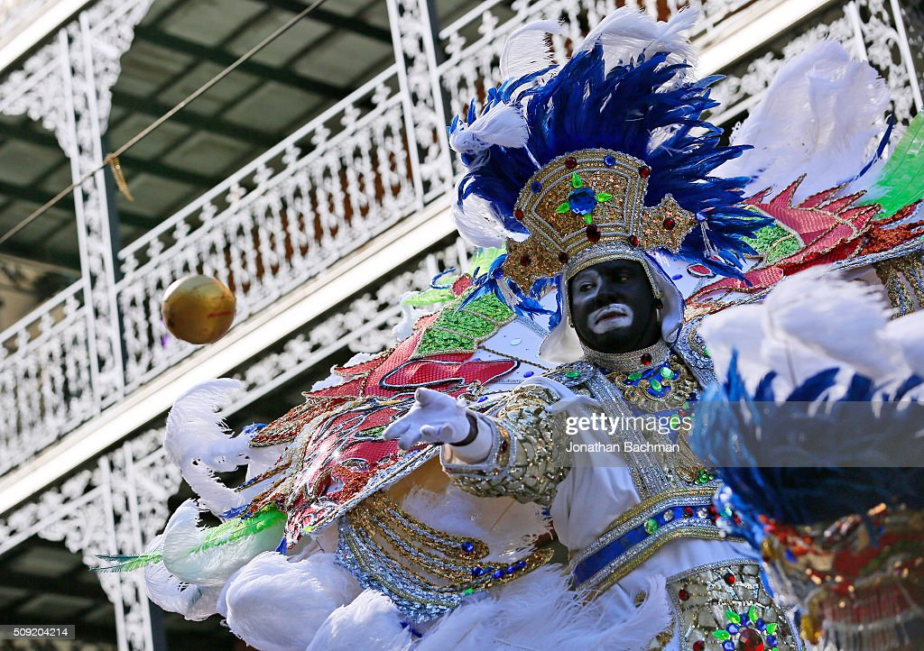 A member of the Zulu Social Aid and Pleasure Club throws a coconut during Mardi Gras day on February 9, 2016 in New Orleans, Louisiana. Fat Tuesday, or Mardi Gras in French, is a celebration traditionally held before the observance of Ash Wednesday and the beginning of the Christian Lenten season.
