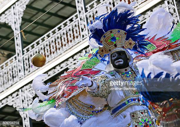 A member of the Zulu Social Aid and Pleasure Club throws a coconut during Mardi Gras day on February 9 2016 in New Orleans Louisiana Fat Tuesday or...